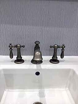 Kohler Co. ARTIFACTS® bell faucet with swing lever handles in Vibrant Polished Nickel